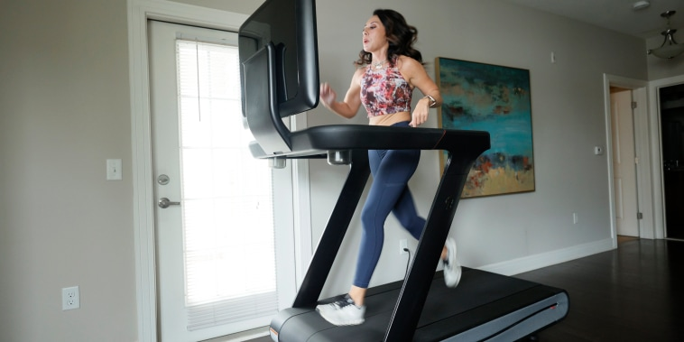 Liza Lecher works out on her Peloton Tread+ treadmill on May 24, 2021, in Williamstown, N.J.