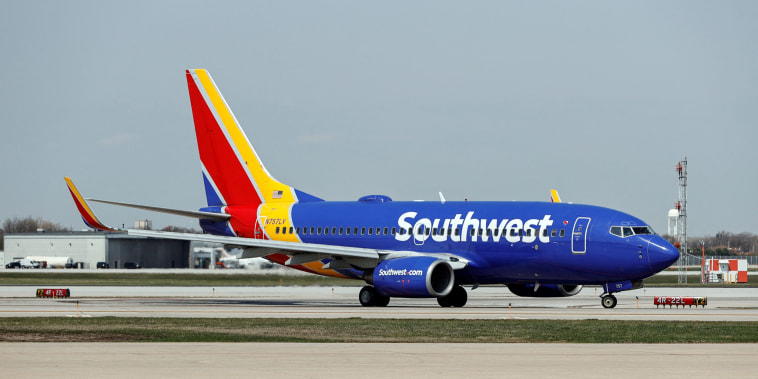 A Southwest Airlines Boeing 737-7H4 jet taxis to the gate after landing at Midway International Airport in Chicago on April 6, 2021.