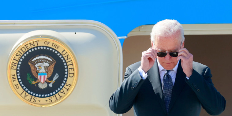 Image: President Joe Biden steps off Air Force One at Cointrin airport as he arrives ahead of a meeting with Russian counterpart Vladimir Putin in Geneva