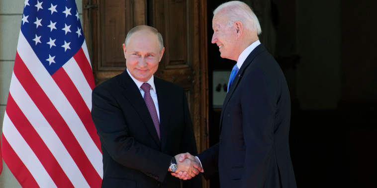 Image: Russian President Vladimir Putin, left, and President Joe Biden shake hands during their meeting at the 'Villa la Grange' in Geneva, Switzerland in Geneva, Switzerland