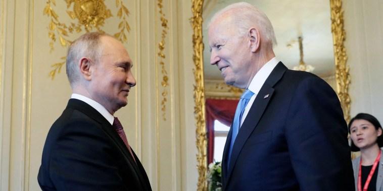 Image: Russian President Vladimir Putin shakes hands with President Joe Biden during their meeting at the 'Villa la Grange' in Geneva, Switzerland,