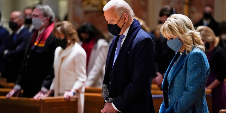 President-elect Joe Biden and his wife, Jill Biden, attend Mass at the Cathedral of St. Matthew the Apostle during Inauguration Day ceremonies in Washington on Jan. 20, 2021.