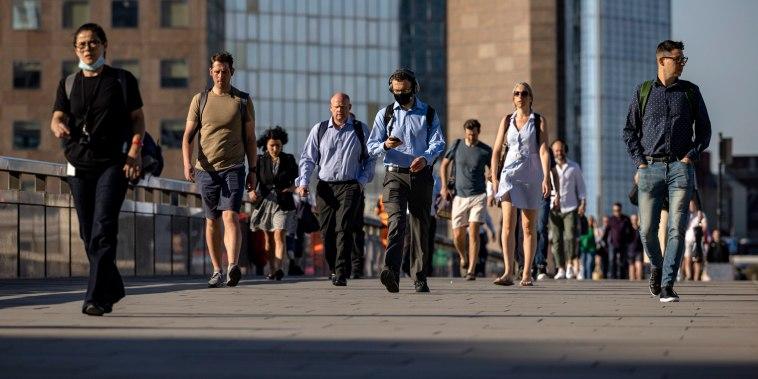 Image: Morning commuters cross London Bridge on June 14, 2021 in London.