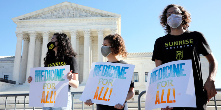 Demonstrators rally outside U.S. Supreme Court in Washington before in an argument on the Affordable Care Act on Nov. 10, 2020.