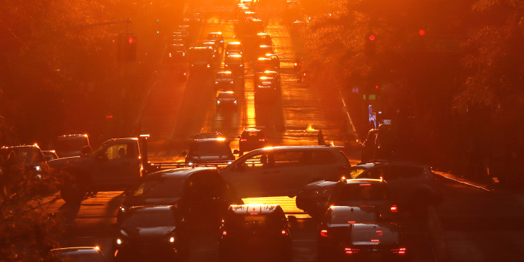 Image: Traffic crosses 42nd Street as the sun sets on June 4, 2021 in New York City.