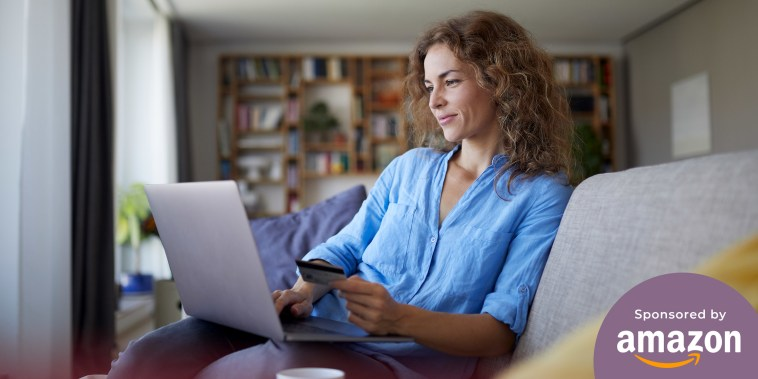 Woman shopping on her laptop in her living room