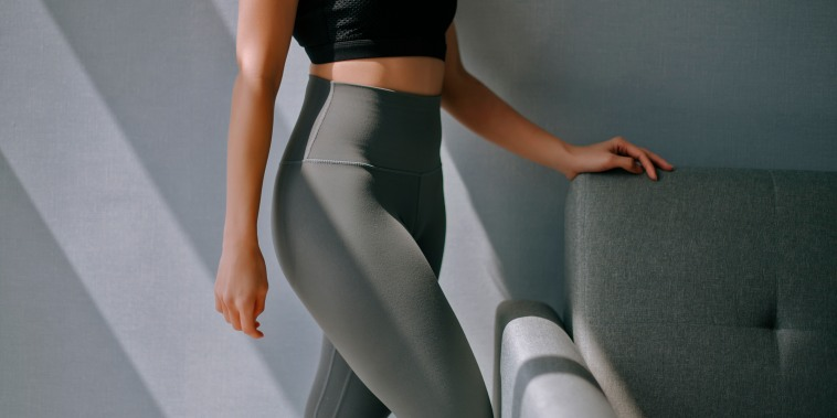 side view mid section of asian chinese woman with yoga pants sport clothing sexual sporty sportive tempting beautiful attractive nice round tight pants leggings