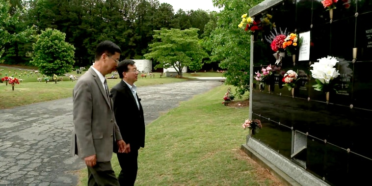 Community organizers Kevin Ying and Charles Li visit the gravesite of Daoyou Feng.