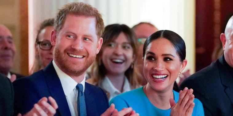 Image: Britain's Prince Harry and his wife Meghan, Duchess of Sussex, cheer during the annual Endeavour Fund Awards at Mansion House