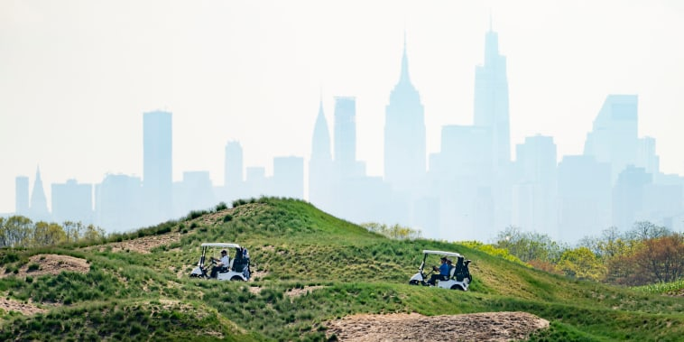 Patrons play at Trump Golf Links at Ferry Point in the Bronx borough of New York on May 4, 2021.