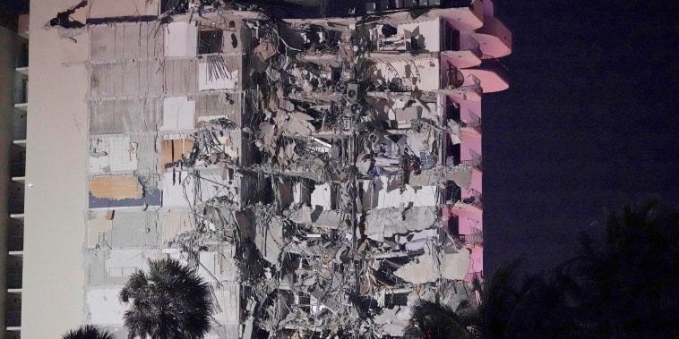 Image: A partially collapsed building is seen early Thursday, June 24, 2021, in the Surfside area of Miami, Fla.