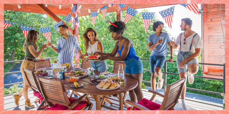 Friends celebrating US Independence Day with an outdoor backyard bbq