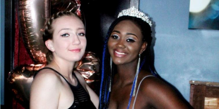 Two young women posing.