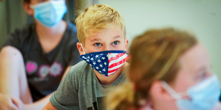 Fifth graders wear face masks during a music class at the Milton Elementary School, Tuesday, May 18, 2021, in Rye, N.Y. Milton reopened to full time, in-person learning in early March for the first time since the coronavirus outbreak.