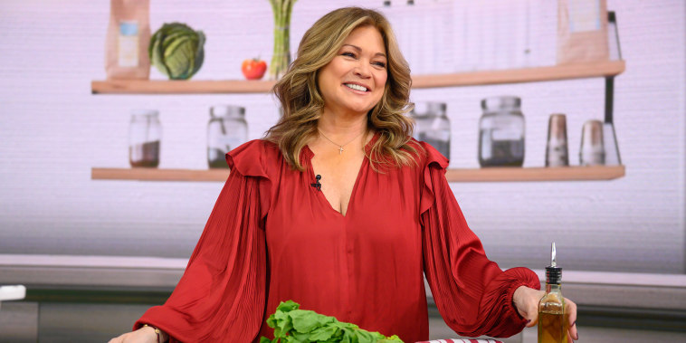 Valerie Bertinelli smiles on the set of TODAY in a red long-sleeve shirt
