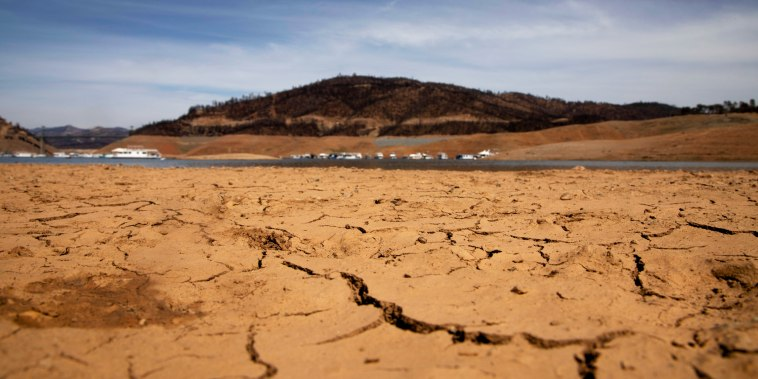 Dry land is visible at a section that is normally under water on the banks of Lake Oroville, which is the second largest reservoir in California, on June 16, 2021.