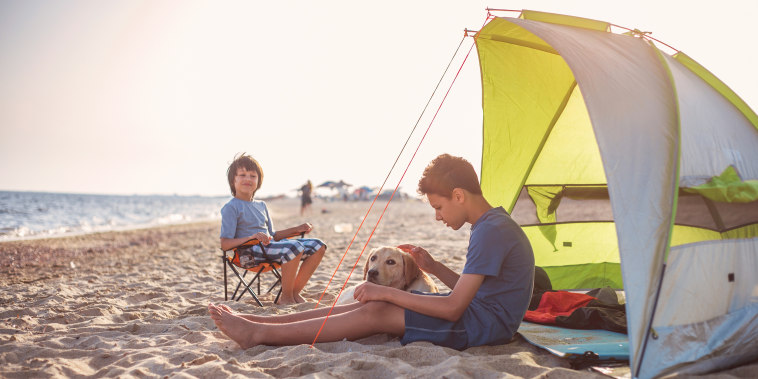 Two boy's camping on the beach