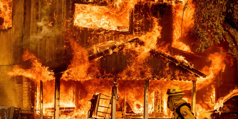 Image: Fire consumes a home as the Sugar Fire, part of the Beckwourth Complex Fire, tears through Doyle, Calif., on July 10, 2021.