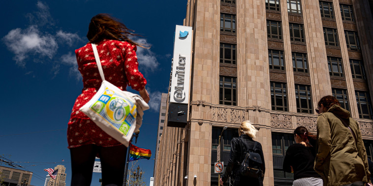 Image: People cross the street in front of the Twitter Inc. headquarters in San Francisco on June 9, 2021.