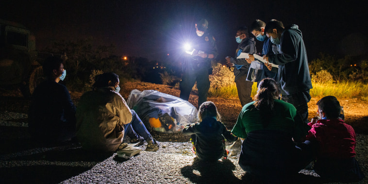 Image: Migrants are accounted for and processed by border patrol after crossing the Rio Grande into the United States on July 1, 2021 in Roma, Texas.