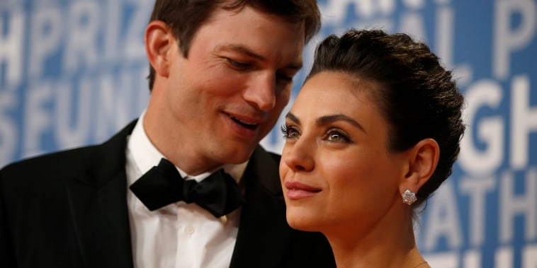 Actor Mila Kunis poses for a picture with her husband actress Ashton Kutcher on the red carpet for the 6th annual 2018 Breakthrough Prizes at Moffett Federal Airfield, Hangar One in Mountain View, Calif., on Sunday, Dec. 3, 2017. (Nhat V. Meyer/Bay Area N