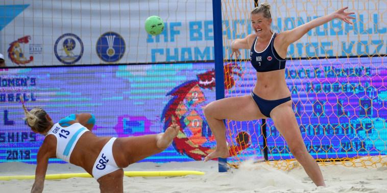 Dimitri Ntafina of Greece shoots during 2018 Women's Beach Handball World Cup final against Berg Saethre Kathrine Margrethe of Norway.
