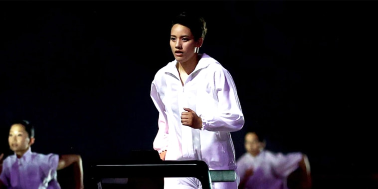 Boxer Arisa Tsubata at the opening ceremony on the treadmill