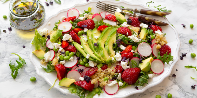 salad with quinoa, rucola, avocado, radish, strawberries, fetacheese, peas