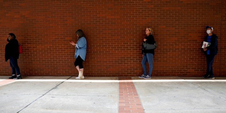 Image: People who lost their jobs wait in line to file for unemployment benefits, following an outbreak of the coronavirus disease (COVID-19), at Arkansas Workforce Center in Fort Smith