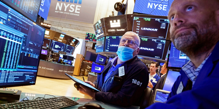 Trader Thomas Ferrigno, left, and specialist Meric Greenbaum work on the floor of the New York Stock Exchange on July 16, 2021.