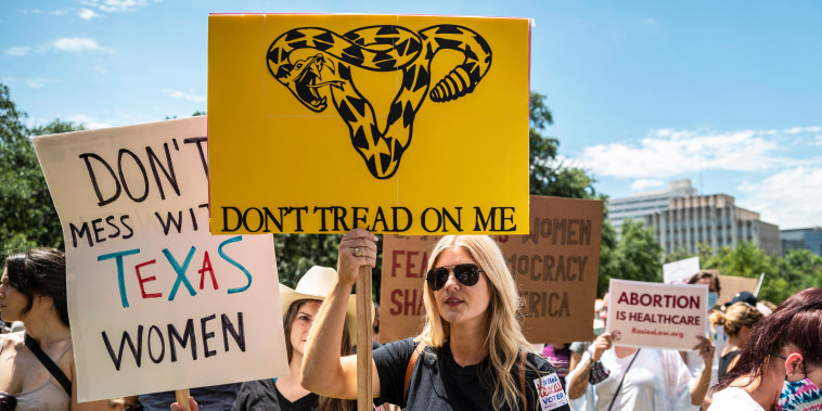 Protesters rally against a bill outlawing abortions after a fetal heartbeat is detected outside the Texas state capitol on May 29, 2021, in Austin.