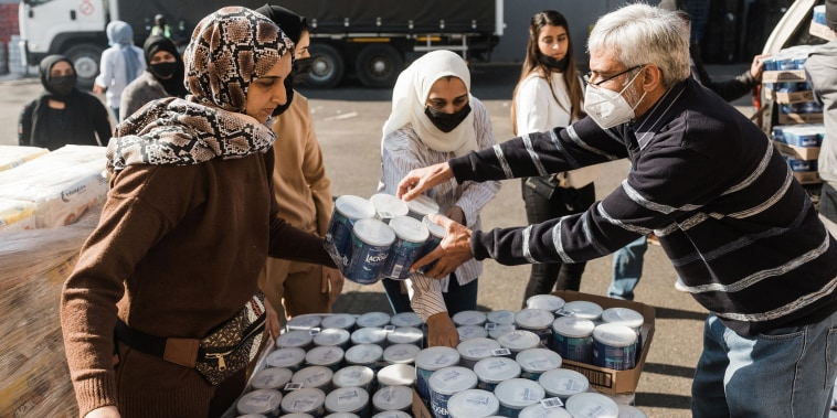 Image: A volunteer from Muslims For Humanity pack baby food at the NMJ Islamic Centre to distribute to members of the public in Durban, South Africa