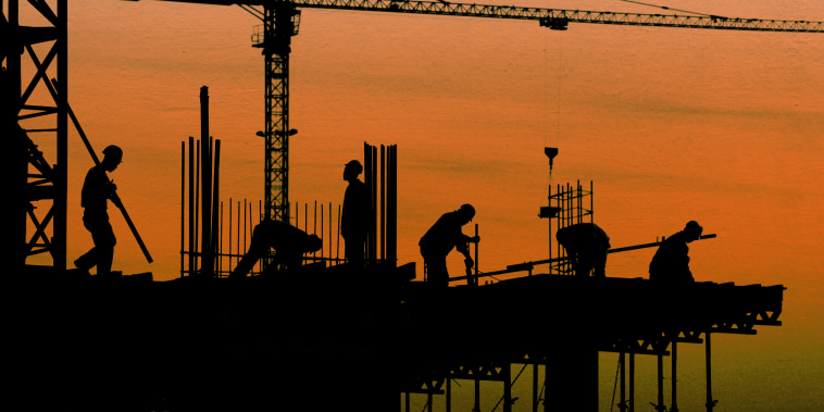 Image of construction workers in silhouette