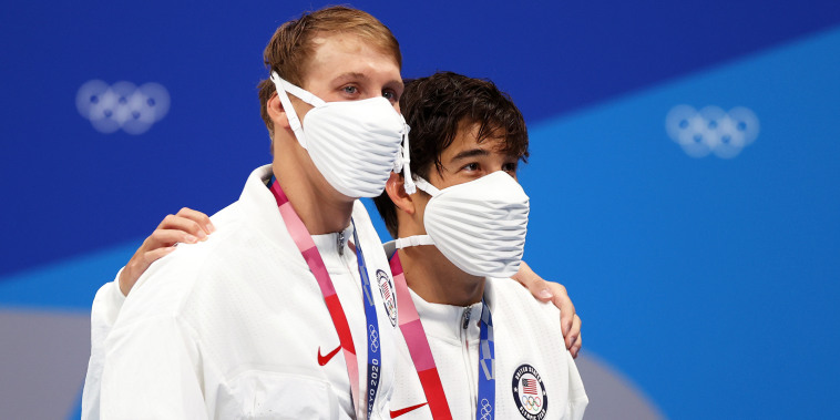 Gold medalist Chase Kalisz and silver medalist Jay Litherland of Team United States pose on the podium