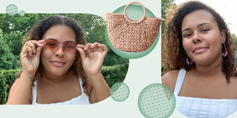 Image of Kamari Stewart wearing the Moloch Acrylic Statement Earrings and Dollger Rimless Rectangle Sunglasses, and the Erouge Natural Chic Straw Bag