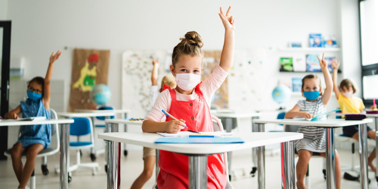 Image of Small children with face mask in school
