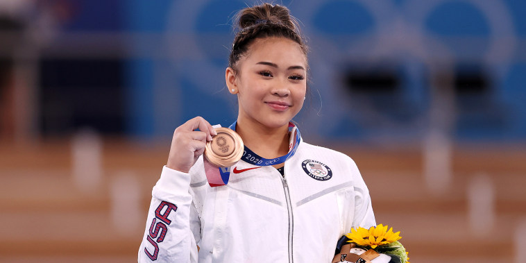 Bronze Medalist Sunisa Lee with her medal on the podium.