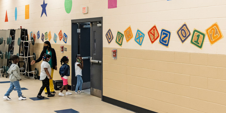 Students are led to their classroom at the start of the day during summer school at Ida Green Elementary in Belzoni, Miss., on June 30, 2021.