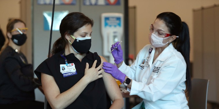 Image: Health Care worker receives vaccine