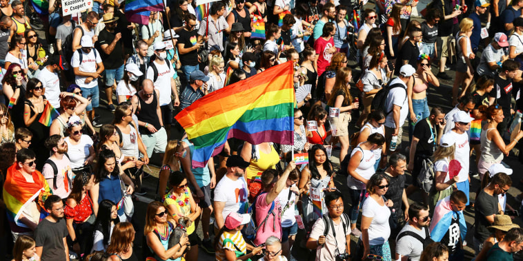 A participant waves a rainbow flag during the Budapest Pride Parade on July 24, 2021.