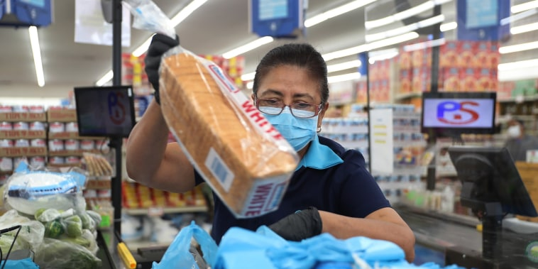 Image: Essential Workers Keep Businesses Open And Serve Customers During COVID-19 Pandemic