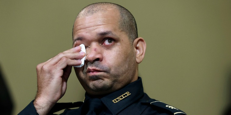 Capitol Police Officer Aquilino Gonell wipes his eyes as he watches a video being displayed during a House select committee hearing on the Jan. 6 attack on Capitol Hill on July 27, 2021.
