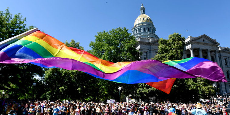 A pride flag flies near the Colorado State Capitol along the Denver Pride Parade route on June 16, 2019 in Denver.