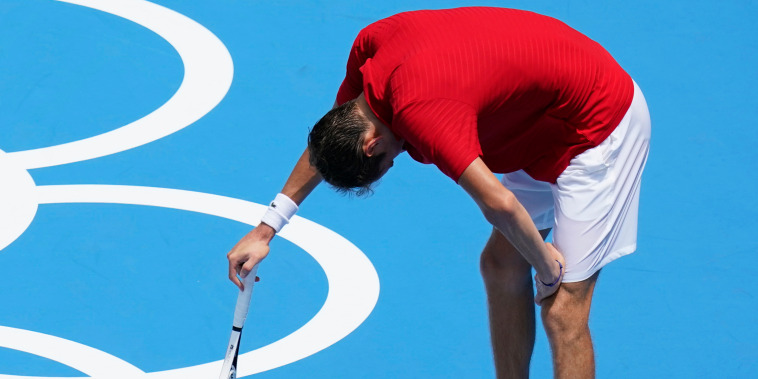 Russia's Daniil Medvedev pauses during a third round men's tennis match against Italy's Fabio Fognini at the Olympics in Tokyo on July 28, 2021.