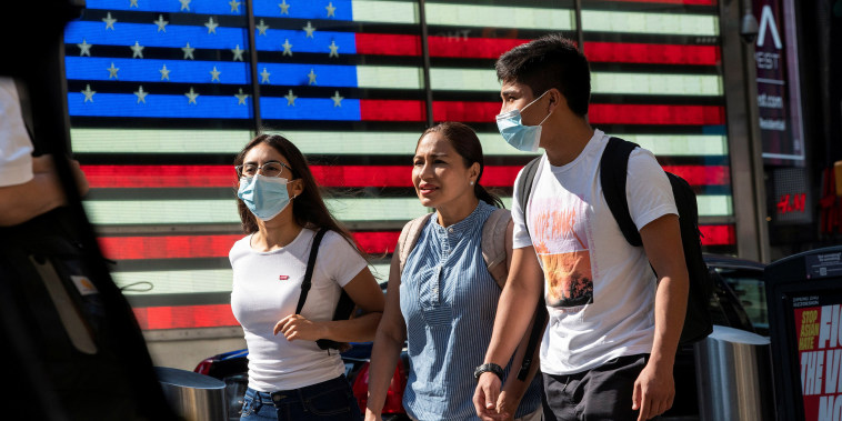 Image: People wear masks around Times Square, as cases of the infectious coronavirus Delta variant continue to rise in New York City, New York