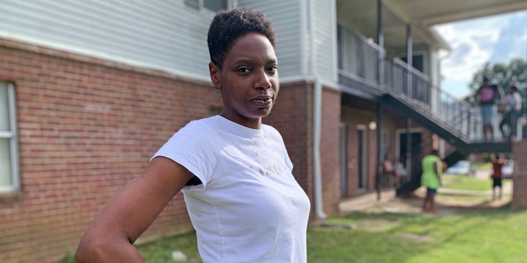 Demia Burse in front of her apartment complex in Jackson, Miss.