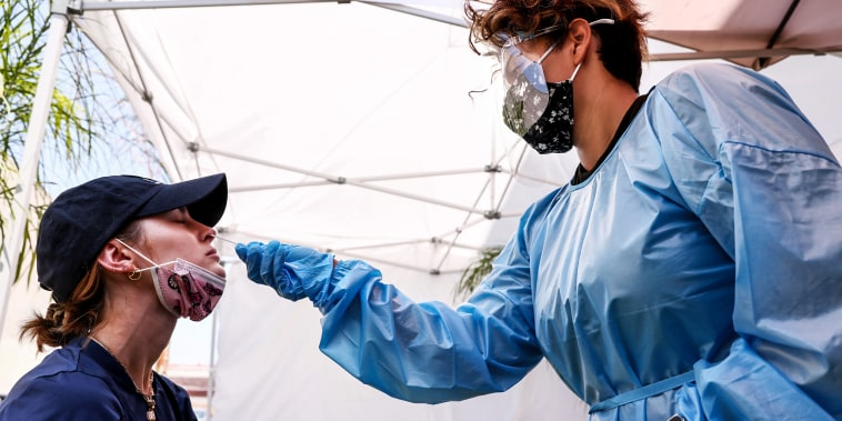 A medical assistant administers a Covid-19 test to a person at Sameday Testing on July 14, 2021 in Los Angeles.