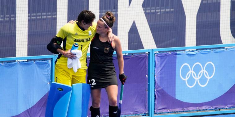 Argentina goalkeeper Maria Belen Succi comforts Germany's Charlotte Stapenhorst.