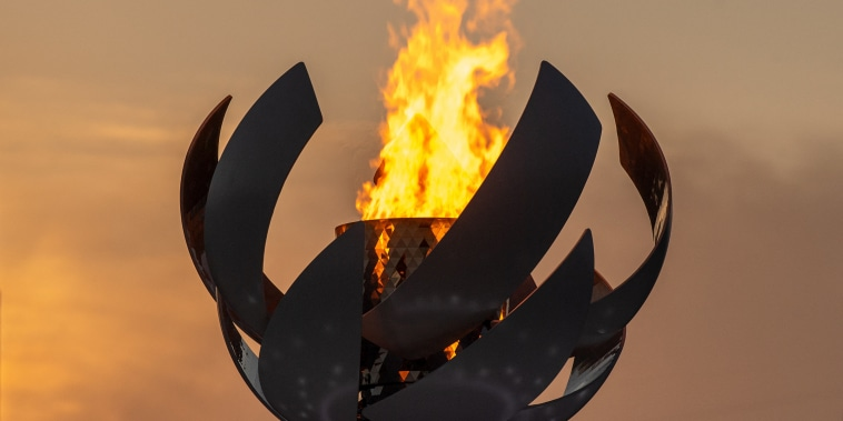 The Olympic flame burning on the cauldron at Ariake Yume-no-Ohashi Bridge in Tokyo.