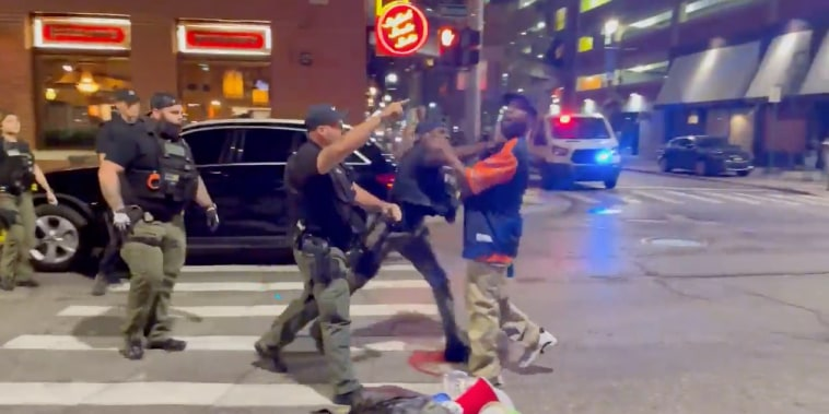 A video recorded Saturday night shows officers approach a man in a Detroit Tigers' shirt, who appeared to be speaking to them when an officer struck him in the face, knocking him to the ground.